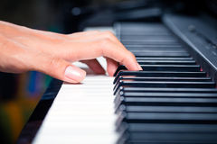 Asian male pianist playing piano in recording studio Stock Image