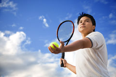 Asian male playing tennis Stock Photos