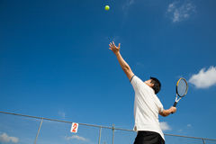 Asian male playing tennis Stock Images