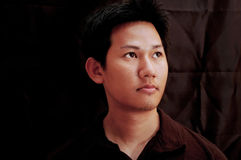 Asian male portrait. Black background royalty free stock images