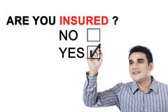 Asian male with question of are you insured Royalty Free Stock Images