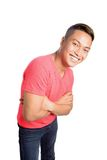 Asian male in red top and denim Stock Photo