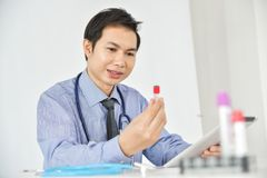 Asian Male Research Scientist. Asian Male Research Scientist is working in the Laboratory Stock Photo