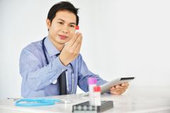 Asian Male Research Scientist is working. Asian Male Research Scientist is working in the Laboratory Stock Photo