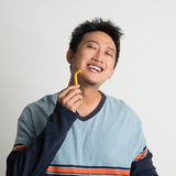 Asian male shaving his beard Stock Images