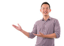 Asian male showing something Stock Images