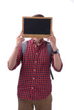 Asian male student covering his face with a chalkboard.  Stock Image