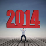 Asian male student lifting 2014. Sign of New year outdoor Stock Photo