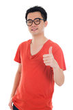 Asian male thumbs up stock photography