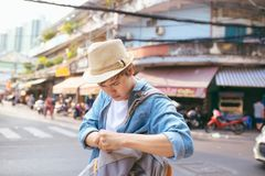 Asian male traveler upset. Lost some important thing concept in. Street Stock Photo