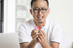 Asian male worried Royalty Free Stock Photo