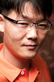 Asian man. Portrait of a handsome young asian man wearing glasses royalty free stock image