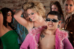 Asian Man at 1970s Disco Music Party. Dancing young people at a 1970s Disco Music Party royalty free stock image