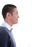 Asian man. Side view Asian man on white background smiling Royalty Free Stock Image
