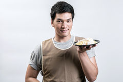 Asian man in apron with spaghetti carbonara Stock Photos