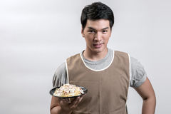 Asian man in apron with spaghetti carbonara Royalty Free Stock Photo