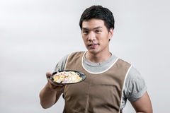 Asian man in apron with spaghetti carbonara Royalty Free Stock Photos