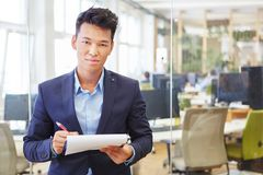 Asian man as competent expert Royalty Free Stock Photo