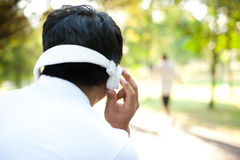 Asian Man back white headphones Stock Images