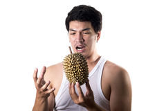 Asian man with bad smell of durian in white background. Photo of Asian man with bad smell of durian in white background stock photos