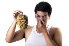 Asian man with bad smell of durian in white background Stock Image