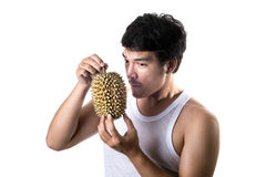 Asian man with bad smell of durian in white background. Photo of Asian man with bad smell of durian in white background stock image