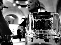 Asian man with beer glass in pub, black and white. Man with beer glass in pub, black and white stock photography