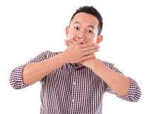 Asian man with big surprise expression. Hand covering mouth, isolated on white background. Asian male model Stock Photography
