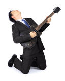 Asian man with a black electric guitar Royalty Free Stock Photos