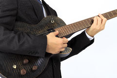 Asian man with a black electric guitar Stock Photo