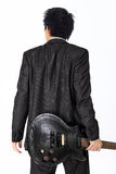 Asian man with a black electric guitar Royalty Free Stock Photography