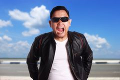 Asian Man in Black Leather Jacket Screaming royalty free stock photo