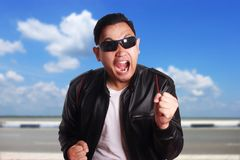 Asian Man in Black Leather Jacket Screaming stock photos