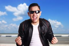 Asian Man in Black Leather Jacket Screaming stock images