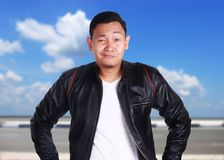 Asian Man in Black Leather Jacket Smiling royalty free stock photos