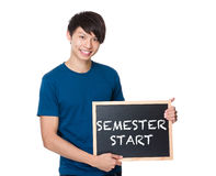 Asian man with the blackboard showing phrase of semester start Stock Images