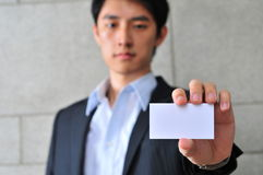 Asian Man with Blank Namecard 16 Royalty Free Stock Photos
