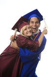 Asian man and blond woman graduates Royalty Free Stock Photography