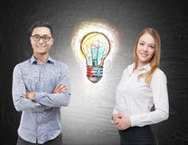 Asian man and blond woman near light bulb sketch Royalty Free Stock Images