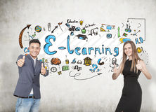 Asian man and blonde woman, e learning Royalty Free Stock Photos