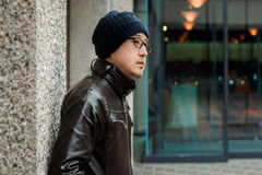 Asian Man in a Brown Jacket Royalty Free Stock Images