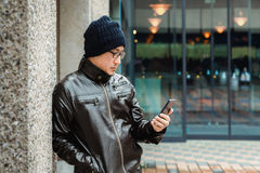 An Asian Man in a Brown Jacket Stock Images