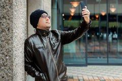 An Asian Man in a Brown Jacket Stock Photos
