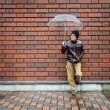 Asian Man in a Brown Jacket With a Clear Umbrella Stock Images
