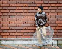 An Asian Man in a Brown Jacket Royalty Free Stock Images
