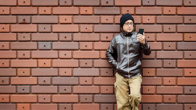 An Asian Man in a Brown Jacket Royalty Free Stock Photography