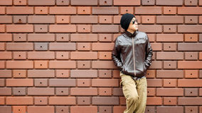 An Asian Man in a Brown Jacket Royalty Free Stock Photos