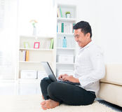 Asian man browsing internet Stock Photography