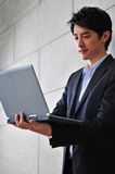 Asian Man In Business Suit Royalty Free Stock Photos