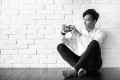 Asian man with a camera black and white Royalty Free Stock Photo